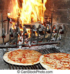 pizza baked in a wood fireplace with a wood-burning oven 3 -...