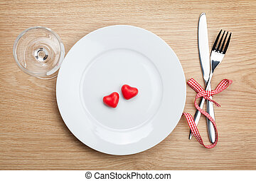 Valentines Day heart shaped candy over plate with silverware...