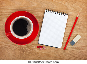 Blank notepad with office supplies and red coffee cup