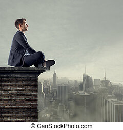 Looking for business opportunities - Businessman sitting on...