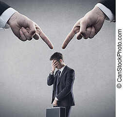 Pointing fingers - Fingers pointing at young employee.Copy...