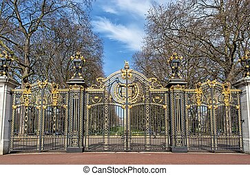 Metal gate decorated with golden ornaments - Metal gate of a...