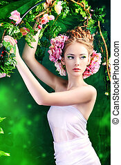 scenic shot - Beautiful young woman standing under an arch...