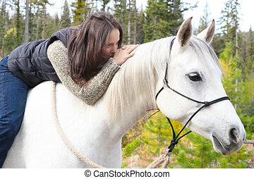Horse and rider - Beautiful brunette female spending time...