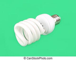 Energy saving fluorescent light bulb on green background