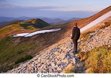 Tourist on mountain trail