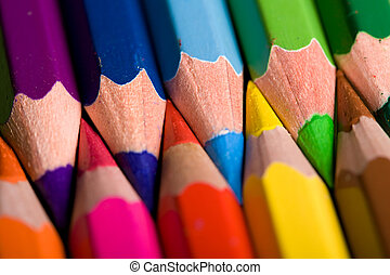Colored pencils in a row - Close shot of a row of colored...