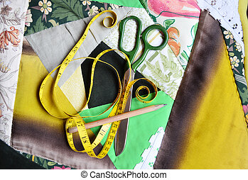 Patchworky chair cushion and tools - Tape-measure, scissors...