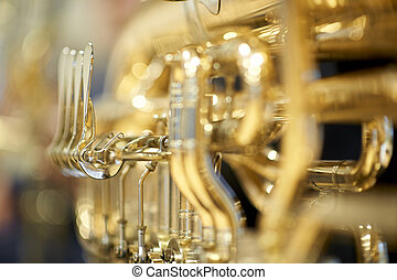 Tuba with valves and tubes close-up