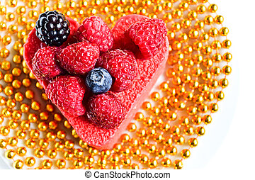 Heart shaped cake with raspberries on top As a gift of a...