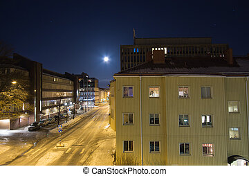 Full moon over sleeping city - Full moon over the city in...
