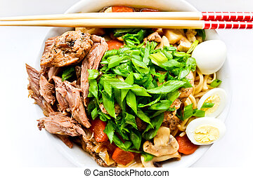 Asian cuisine - Japanese dish with noodles, meat and...