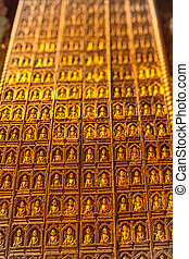 Pindaya caves - The tiny gold-plated statues of Buddha in...