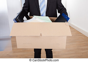Businessman Moving Out With Cardboard Box - Midsection of...
