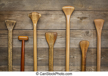 grips of canoe paddles - grips and shafts of old wooden...