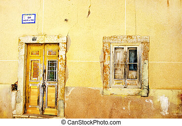 Facade of antique ruined house,Algarve,Portugal