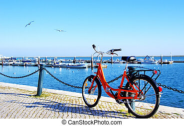 Bike parked along the port of Algarve sea