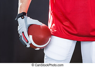 Confident American Football Player On Field - Close-up of...