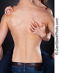 Passionate Woman's Hand Scratching Shirtless Man's Back