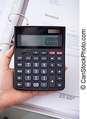 Accountant Holding Calculator - High angle view of female...