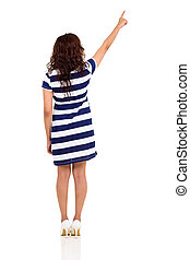 back view of young woman pointing up