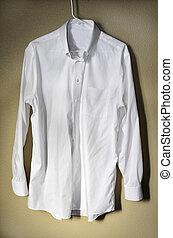 White Dress Shirt Hanger - Detail of white dress shirt...