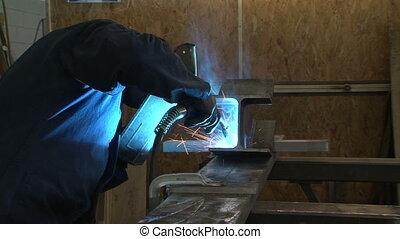 Man welding piece of metal