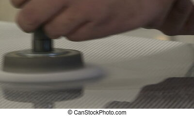 Worker sanding carbon fibre - Worker sanding and smoothing...