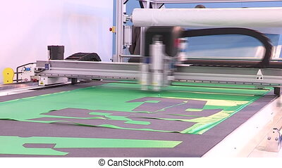 Machine cutting shapes with laser