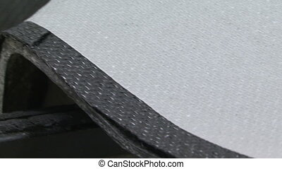 Rough carbon fibre being assembled by worker