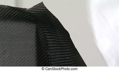 Man working on carbon fibre piece - Man assembling carbon...