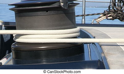 Sailor manoeuvring winch - Sailor manoeuvring the winch on...