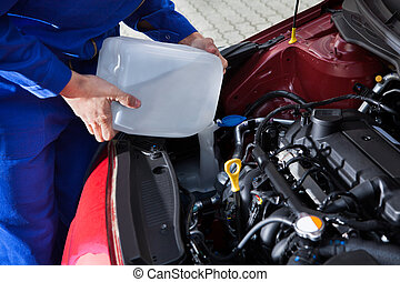 Mechanic Pouring Antifreeze Into Windscreen Water Tank -...