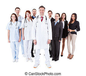Doctor standing in front of his team Isolated on white