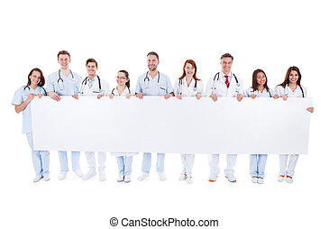 Large group of doctors and nurses with a banner - Large...