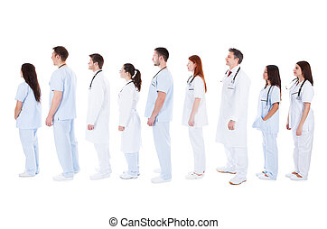 large group of medical staff standing in a queue - Large...