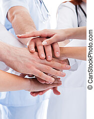 Medical team stacking hands - Doctors and nurses in a...