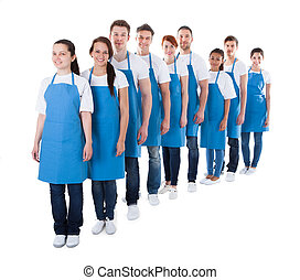 Large group of cleaners standing in a line - Large diverse...