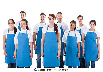 Diverse group of professional cleaners. Isolated on white