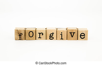 forgive wording, ethic and merit concept - closeup forgive...