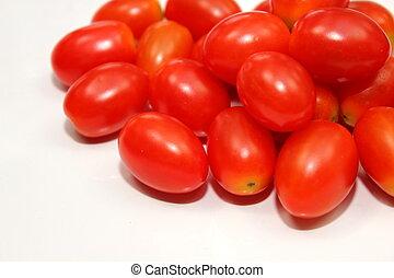Small tomato on white background