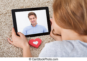 Woman Video Chatting On Digital Tablet