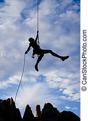 Rock climber rappelling - A climber rappelling from the...