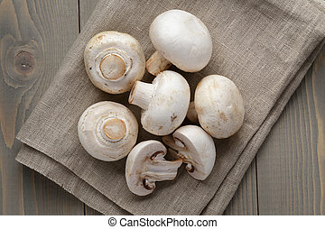 fresh white champignon on wood table, rustic style photo