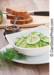 Fresh salad of cucumbers with dill and pepper