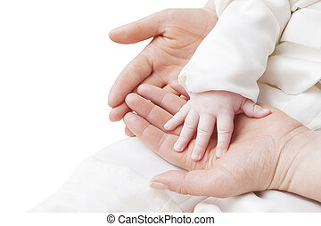 hand of a child in mother's hands