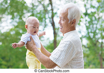 Asian grandfather and grandson - Asian grandfather having...