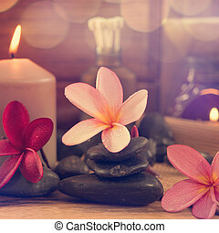 Spa setting with candle light - Spa setting with frangipani...