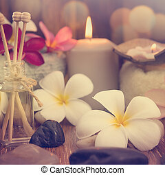 Wellness and spa concept with candles, frangipani flower,...