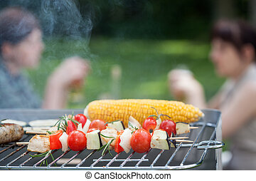 Grilled veggies - Tomatoes, courgette, corn and chicken on a...